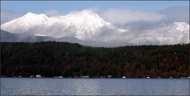 Late December snowfall blankets the Olympic Mountains. Hood Canal is in the foreground. Photo: Jeff Larsen/Seattle Post-Intelligencer