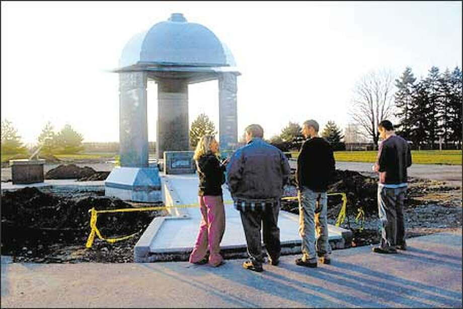 Lucy Woodhouse, from left, John Heaton, Iain Betterton and Will Arnold visit Hendrix's memorial in Renton. It was the first stop that Londoners Woodhouse and Betterton made after dropping off their bags at Heaton's house. Photo: Grant M. Haller/Seattle Post-Intelligencer