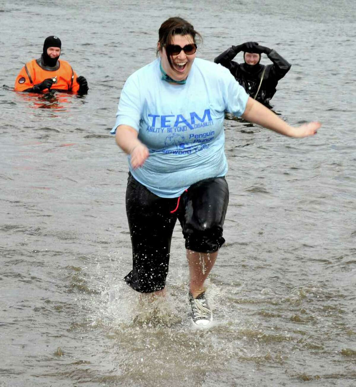 Michelle Weinstein, 32, of Newtown, comes out of the water during the 2nd Annual Penguin Plunge to benefit the Special Olympics at Candlewood Town Park in Danbury, Sunday, March 13, 2011.