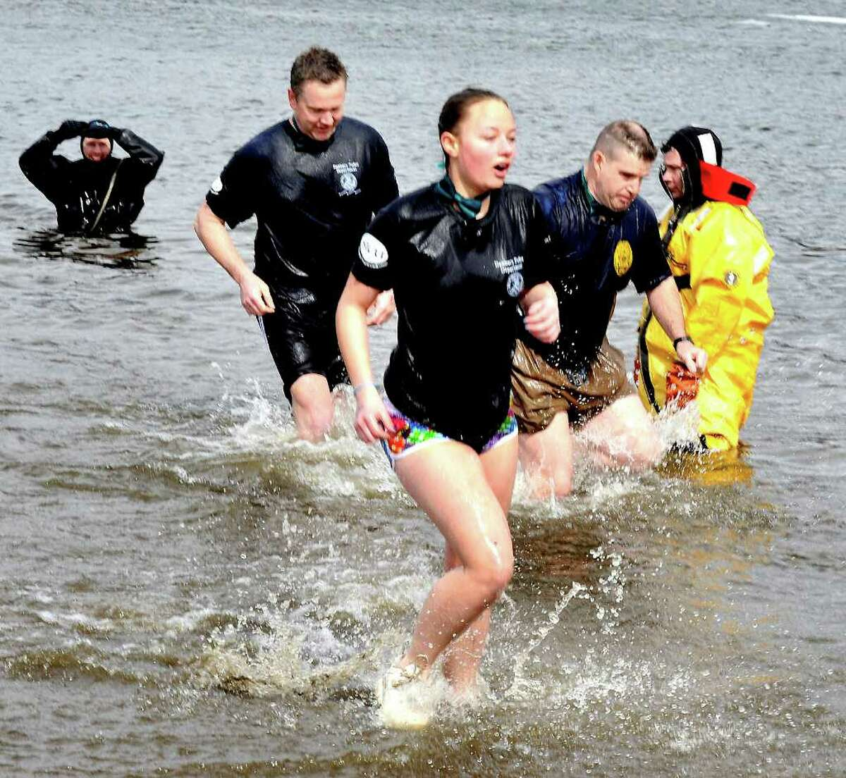 Nicole Sutor, 15, comes out of the water with the Danbury Police team, during the 2nd Annual Penguin Plunge to benefit the Special Olympics at Candlewood Town Park in Danbury, Sunday, March 13, 2011.