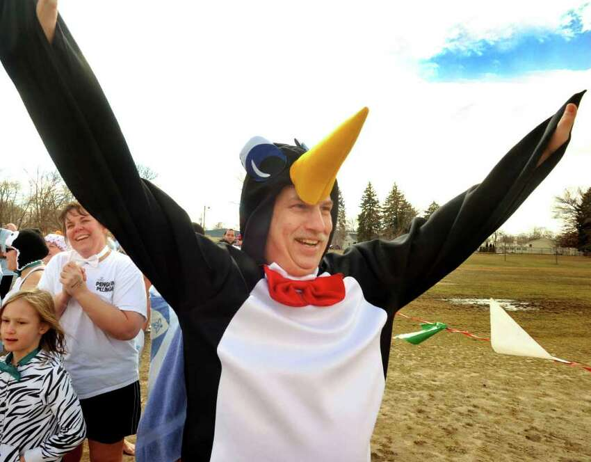 David Kimmel, of Danbury, prepares to take the plunge during the 2nd Annual Penguin Plunge to benefit the Special Olympics at Candlewood Town Park in Danbury, Sunday, March 13, 2011.