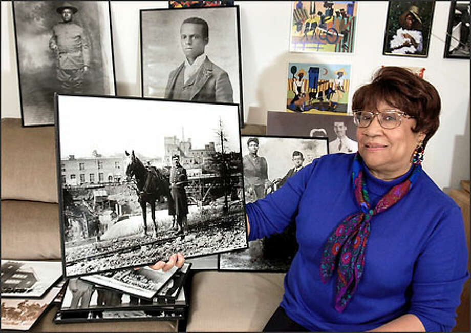 Jerrelene Williamson displays a photo of Henry W. Sample, the first black policeman in Spokane from 1892-1894, as part of her collection of African-American history from the Spokane area in her basement in Spokane, Wash., Wednesday, Feb. 26, 2003. The photo is one of her favorites from the collection. Williamson is honored as part of the Jefferson Awards from The Seattle P-I. Photo: Jeff T. Green/for The Seattle Post-Intelligencer