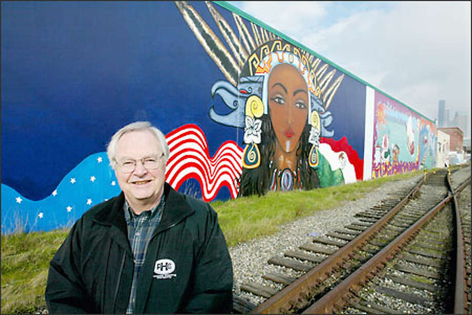 Mike Peringer created the SODO Urban Art Corridor, which features murals prdouced by local youth on what were once graffiti-covered buildings. Photo: Paul Joseph Brown/Seattle Post-Intelligencer