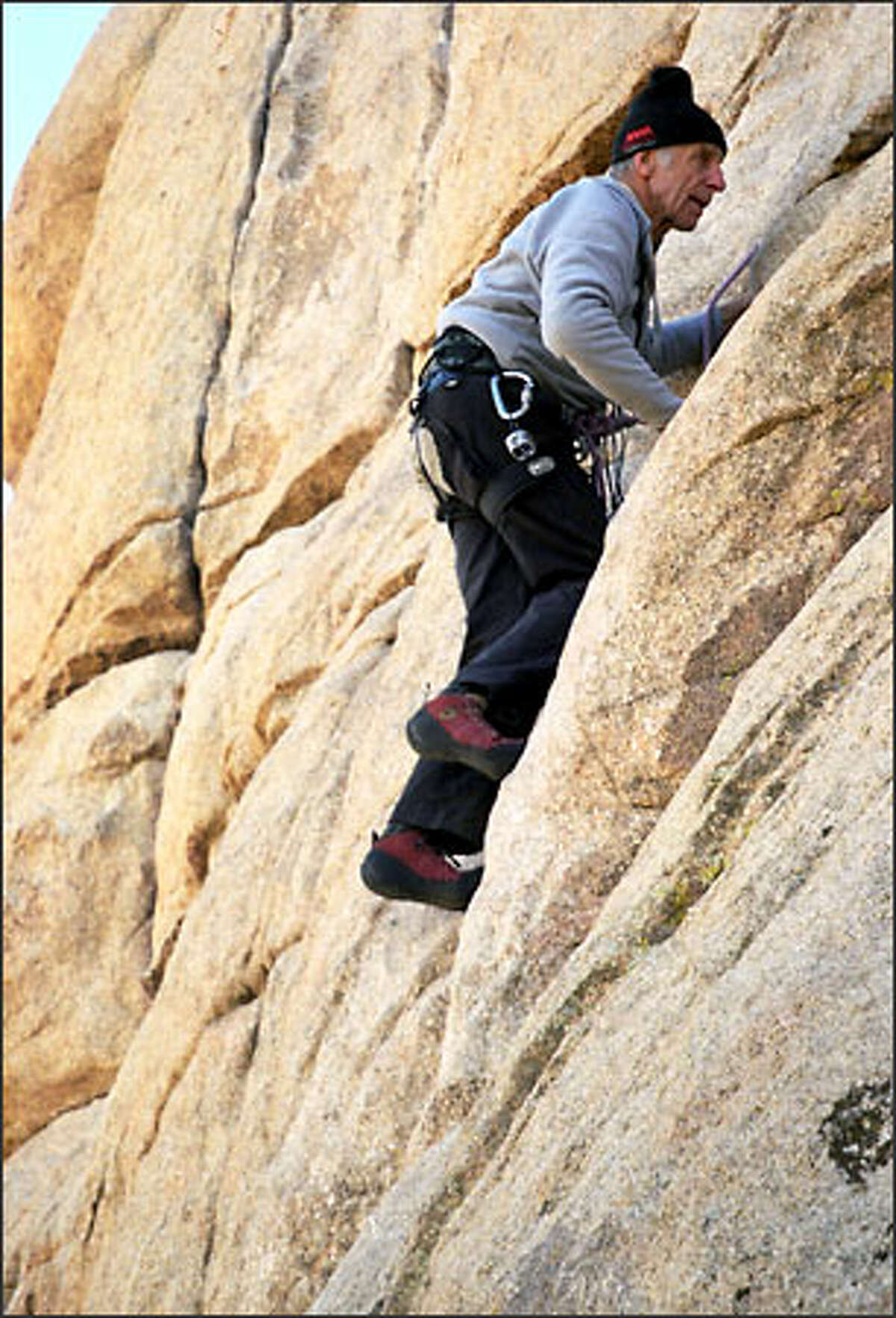 Fred Beckey ascends Sail Away, a route on Hidden Tower, a rock pinnacle in Southern California's Joshua Tree National Park, on New Year's Day. Beckey, whose 80th birthday was Jan. 14, has been climbing throughout the world since he was a teenager growing up in Seattle.