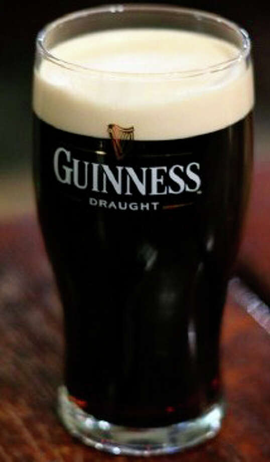 A foaming glass of Guinness, a frothy favorite for many celebrants of St. Patrick's Day. Photo: Contributed Photo / Westport News contributed