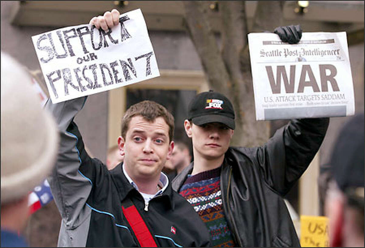 Nathan Meagher and Stephen Jackson turned out in downtown Seattle to support military action in Iraq, but found it difficult to sway demonstrators to their way of thinking.