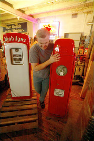 Rich Fotheringill loads a gas pump onto a pallet to be shipped to Bloomington, Ill., to be auctioned in June. The pump is part of the collection of the General Petroleum Museum, which closed in February. Photo: Phil H. Webber/Seattle Post-Intelligencer