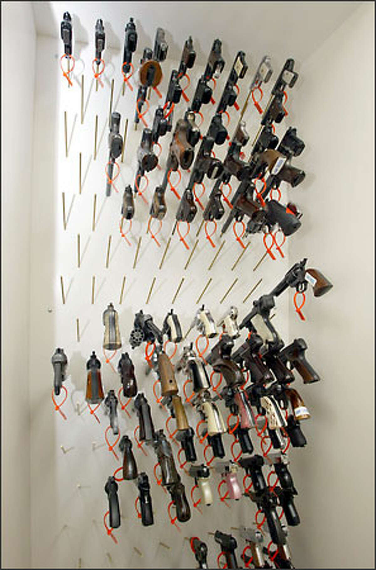 Forensic scientists at the crime lab have started a huge firearms collection for use in comparison and identification of weapons.