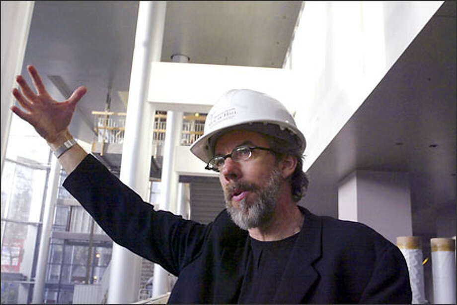 Lead designer Mark Reddington, a partner in LMN Architects, explains how natural light passing through the five-story bank of windows at the entrance to McCaw Hall will affect the color of the ceiling and walls of the grand lobby. Photo: Jim Bryant/Seattle Post-Intelligencer