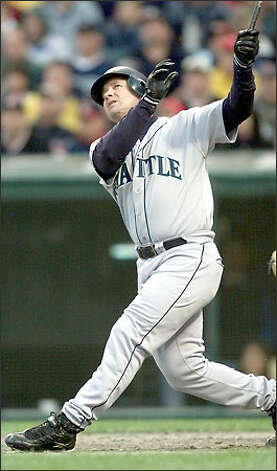 The classic swing has brought Edgar Martinez two AL batting titles. He won his first in 1992 (.343) and his second in 1995 (.356). Photo: / P-I File