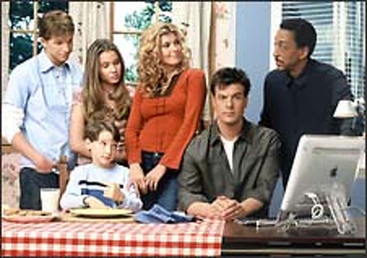 """""""Lost at Home"""" stars Mitch Rouse as dad Michael, Connie Britton as mom Rachel and Gregory Hines as Jordan. The kids include Stark Sands as Will, Leah Pipes as Sara and Gavin Fink as Joshua."""