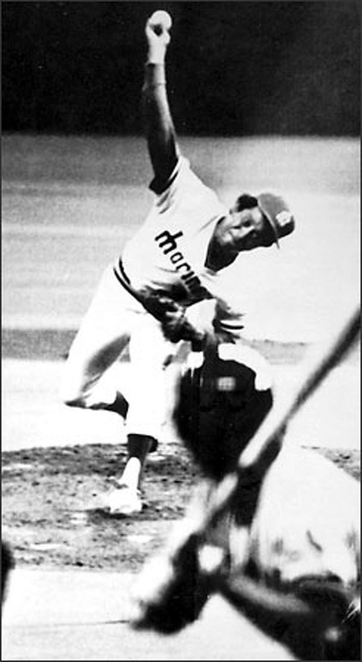 Diego Segui throws the Mariners' first-ever pitch, a called strike against Jerry Remy of the California Angels on April 6, 1977 at the Kingdome. The Mariners lost the contest 7-0.