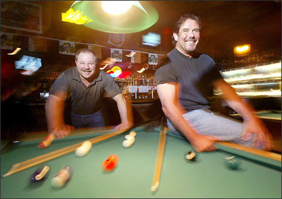 Marty Zorich, left, and Joe D'Ambrosio, owners of Waldo's Tavern in Kirkland's Rose Hill area, are boyhood friends who have owned the bar for 25 years. Photo: Dan DeLong/Seattle Post-Intelligencer