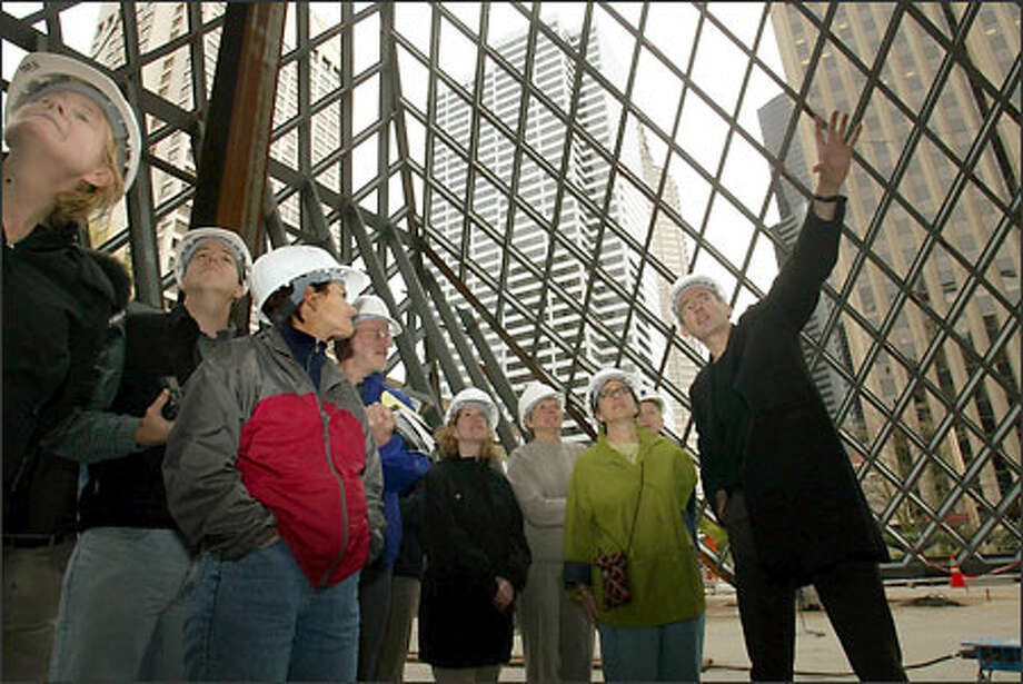 Architect Rem Koolhaas gives a tour of Seattle's central library to donors and friends of Seattle Public Library. The building is scheduled to be finished early next year. Photo: Mike Urban/Seattle Post-Intelligencer