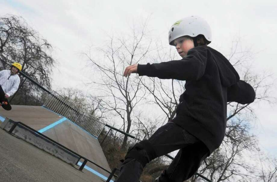 Dennis Murphy, 11, right, and his friend Jack Stefanou, left, both of Greenwich, skateboarding at Greenwich Skatepark, at the opening of the season on Sunday, March 13, 2011. Photo: Helen Neafsey / Greenwich Time
