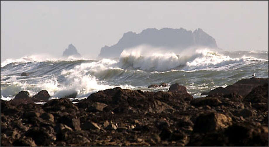 Spectacular waves crash against the rocky shore of the Washington coast as the tide comes in near Cape Alava. Photo: Jeff Larsen/Seattle Post-Intelligencer