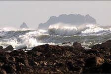 Spectacular waves crash against the rocky shore of the Washington coast as the tide comes in near Cape Alava.