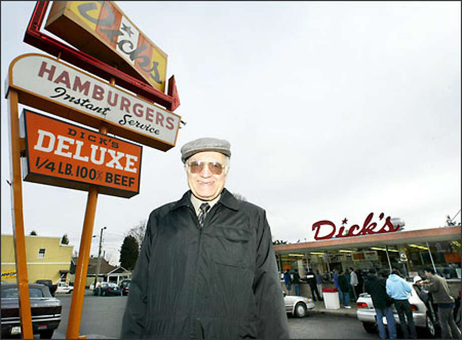 Dick Spady stands in front of one of his drive-in restaurants. Photo: Jim Bryant/Seattle Post-Intelligencer