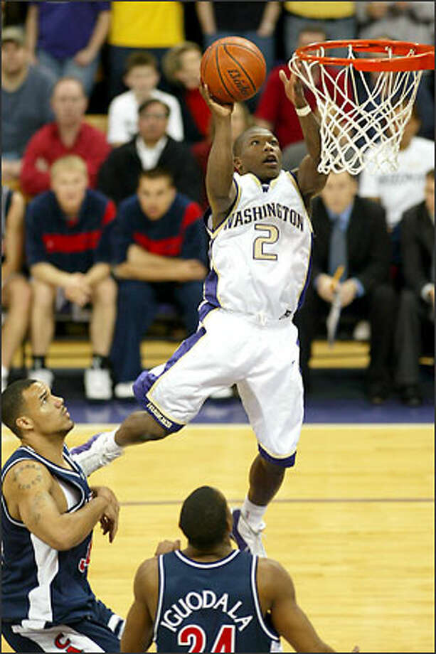 Point guard Nate Robinson played 23 games last season for Washington, starting the final 10. Although he missed four games because of football commitments, Robinson led the Huskies in scoring at 13 points a game and was second on the team with 52 assists. Photo: Mike Urban/Seattle Post-Intelligencer