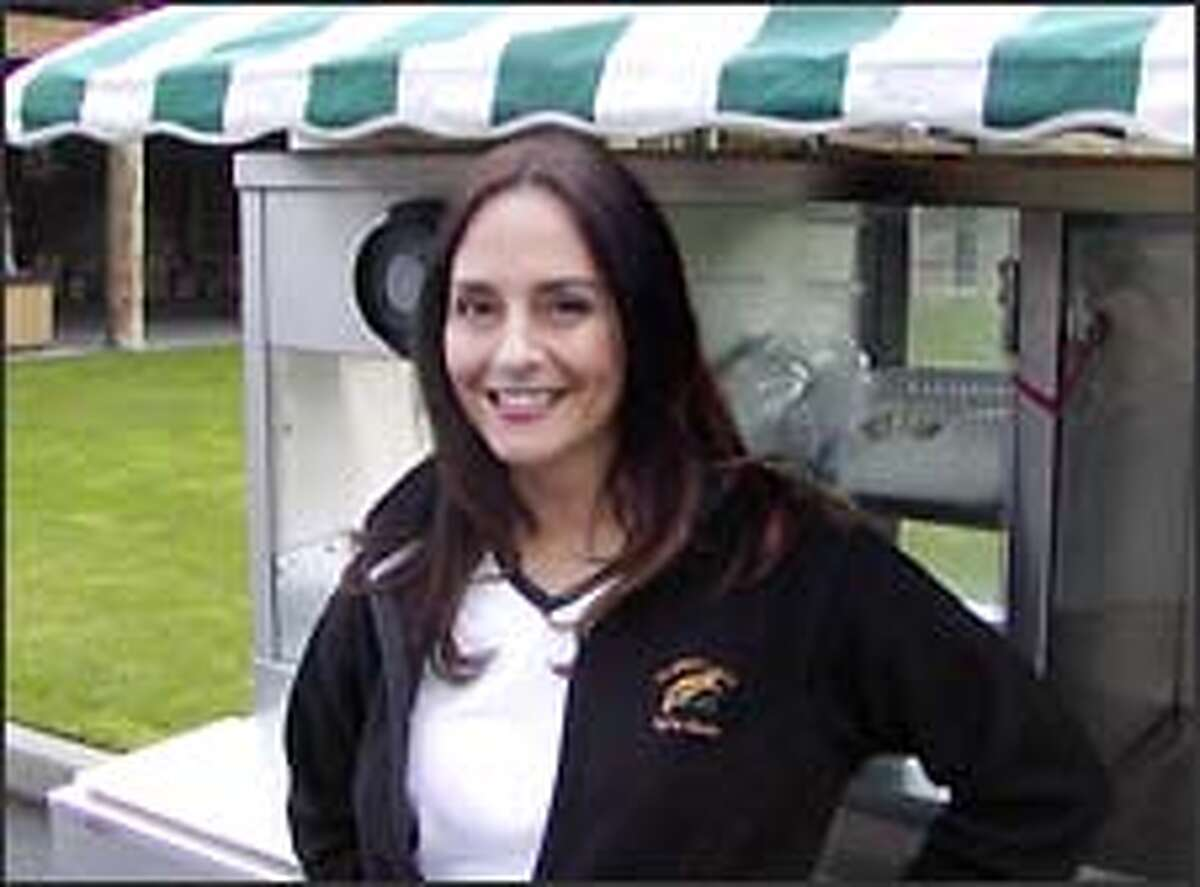 Theresa Murphy is a beverage cart girl at Trophy Lake.