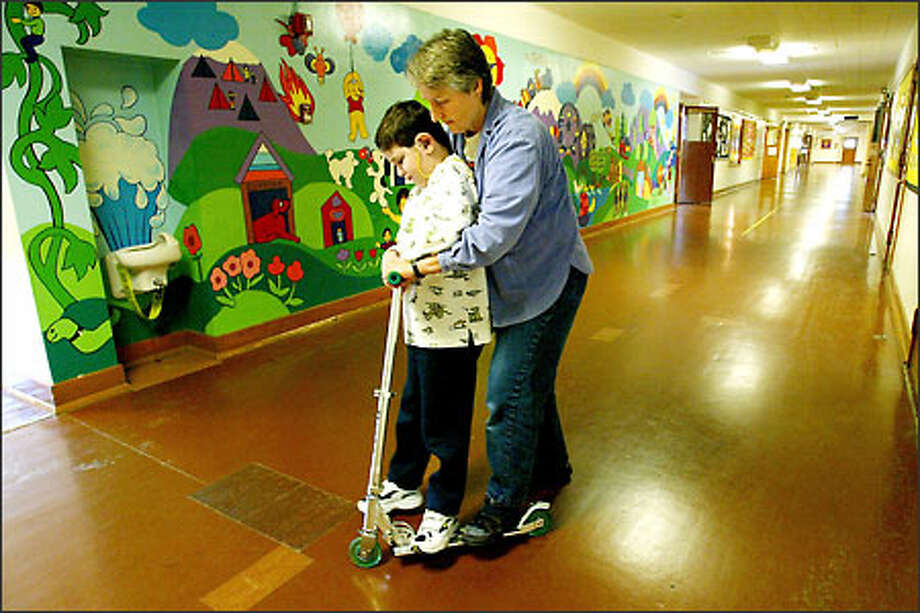 The View Ridge Elementary School class that Joseph Cancela, 8, attends will be closed. Joseph, who is blind and deaf, is being helped by Meg Johnson, his one-on-one aide. Photo: Paul Joseph Brown/Seattle Post-Intelligencer