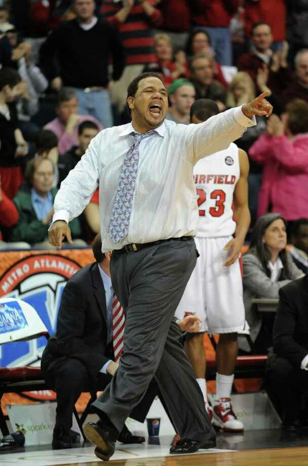 Fairfield head coach Ed Cooley shouts instructions to his players during the MAAC men's basketball tournament at the Webster Bank Arena at Harbor Yard in Bridgeport recently. The Stags, who lost in the MAAC tourney semifinals, are headed to the NIT. Photo: Brian A. Pounds / Connecticut Post