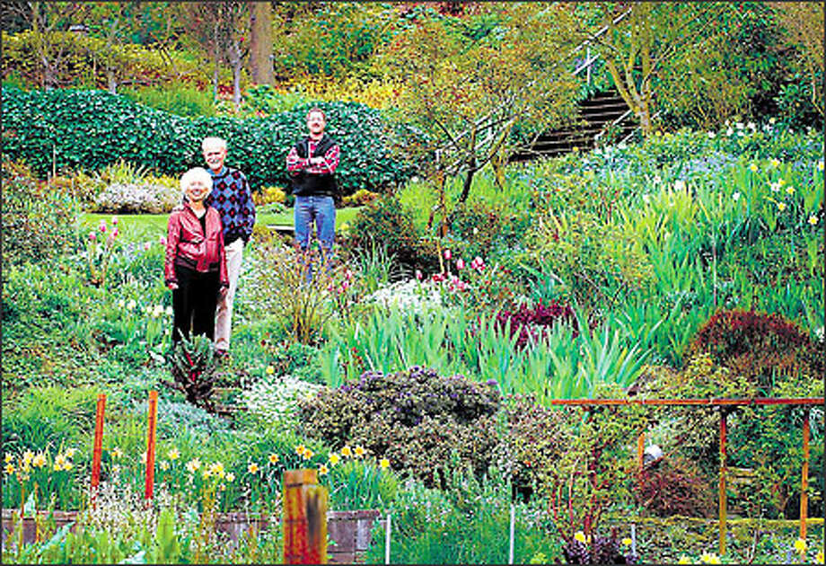 Ann and Dan Streissguth, with their son, Ben, stand in the Capitol Hill garden they donated to the city of Seattle. Photo: Dan DeLong/Seattle Post-Intelligencer