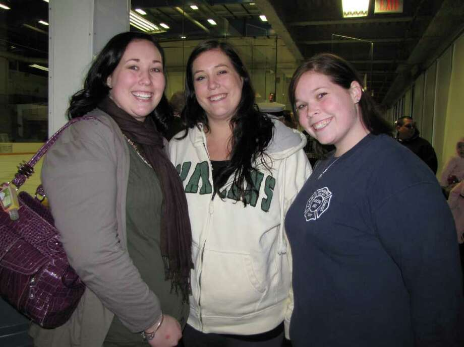 """Were you seen at the eighth-annual charity hockey game between the Danbury Police Department and the Danbury Fire Department on March 13, 2011 at the Danbury Ice Arena?"" Photo: Vincent Rodriguez / The News-Times"