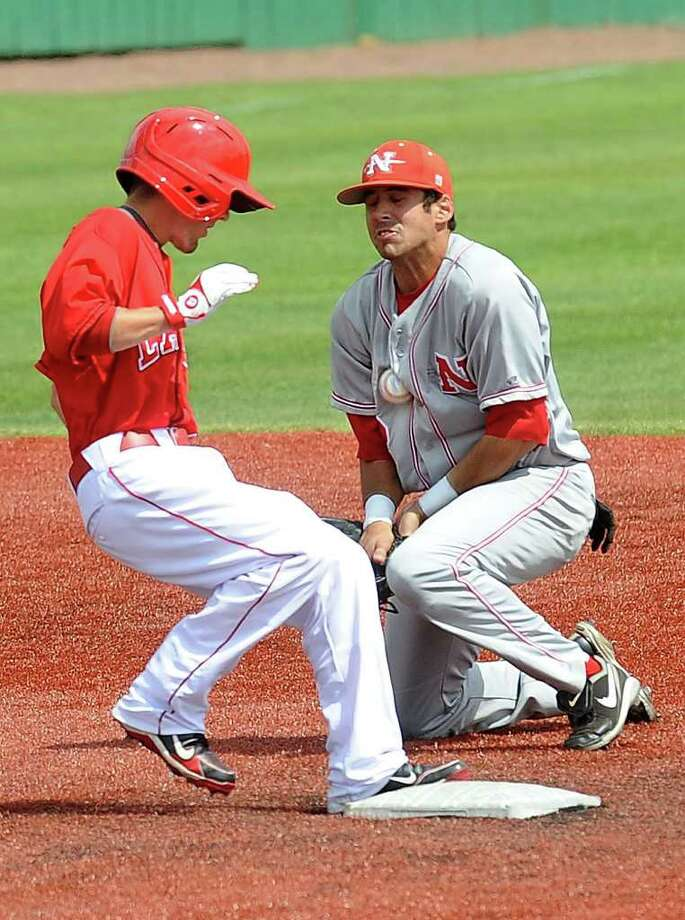 Nicholls State's second basemen catches the ball in his chest as Lamar's Aaron Buchanan steps safely onto the plate during a match up at Vincent Beck Stadium on Sunday. Guiseppe Barranco/The Enterprise Photo: Guiseppe Barranco / Beaumont