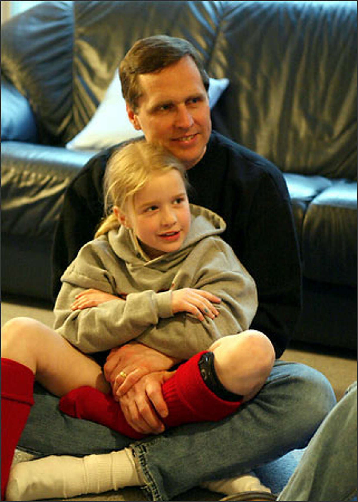 Haley Gadzik sits with her dad, Charlie Gadzik, at a meeting of Y-Princesses, a group designed to foster parent-child relationships.
