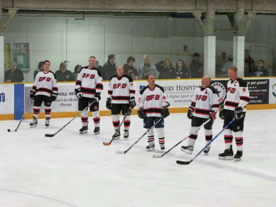 """""""Were you seen at the eighth-annual charity hockey game between the Danbury Police Department and the Danbury Fire Department on March 13, 2011 at the Danbury Ice Arena?"""" Photo: Vincent Rodriguez / The News-Times"""