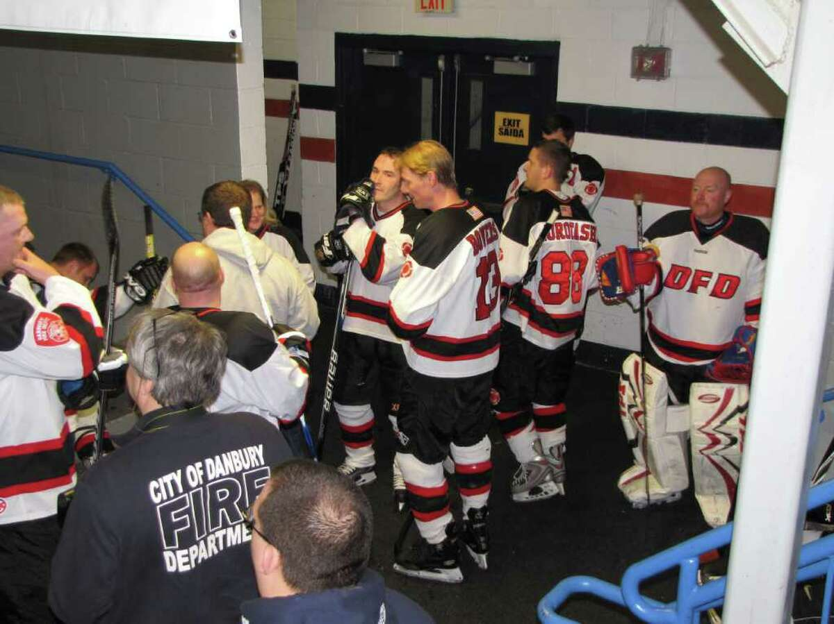"""""""Were you seen at the eighth-annual charity hockey game between the Danbury Police Department and the Danbury Fire Department on March 13, 2011 at the Danbury Ice Arena?"""""""