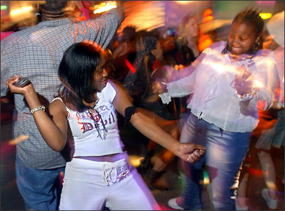 Cafe Arizona patrons Jessica Cunningham, left, and Karisha Pierce dance at the Federal Way nightclub on a Friday night. Dancing is the main attraction at the club, the owners say. Photo: Ron Wurzer/Seattle Post-Intelligencer