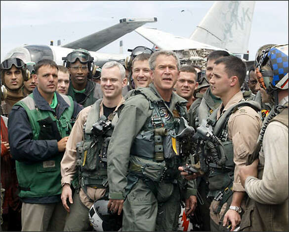 President Bush waves to crew members after his speech yesterday on the aircraft carrier USS Abraham Lincoln. Bush visited the ship as it headed for San Diego. Photo: Grant M. Haller/Seattle Post-Intelligencer