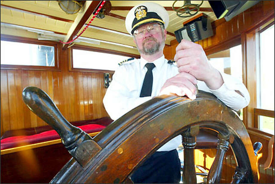 Dale Pederson, captain of the Virginia V, traces his own attraction to the steamship to memories of a trip as a boy. Photo: Mike Urban/Seattle Post-Intelligencer