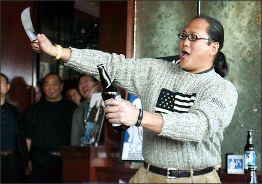 Iron Chef Masaharu Morimoto opens a beer bottle with an unconventional tool during a Seattle promotional appearance. Photo: /Seattle Post-Intelligencer