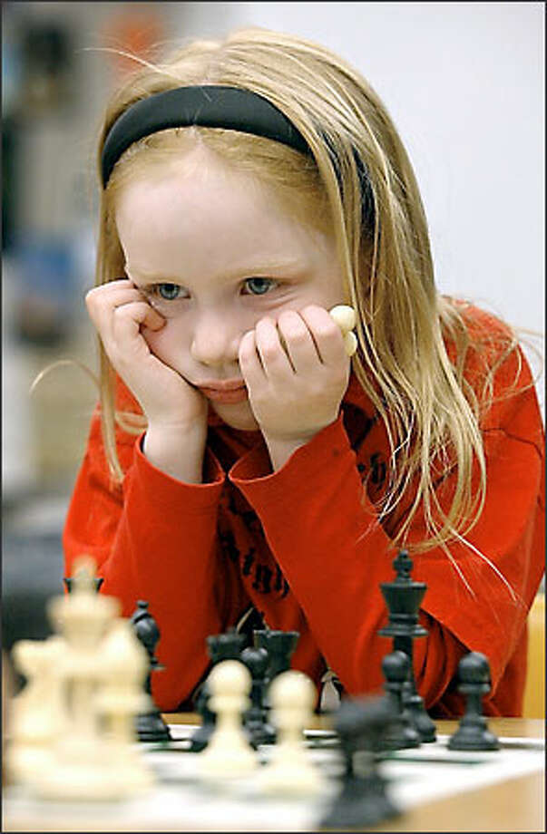 The Knightmares from The Evergreen School in Shoreline captured a first-place team victory in a kindergarten-through-third-grade tournament at the National Elementary Chess Championship in Nashville, Tenn., last weekend. Molly-Rose Clarfeld assisted in the victory. Photo: Gilbert W. Arias/Seattle Post-Intelligencer