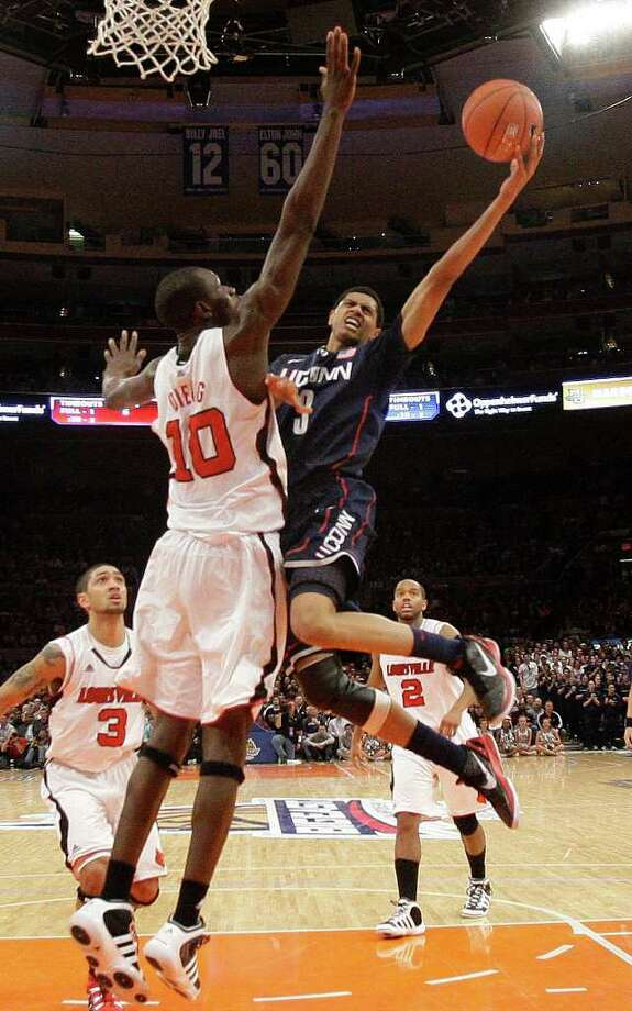 Connecticut's Jeremy Lamb (3) drives past Louisville's Gorgui Dieng (10) during the first half of an NCAA college basketball game at the Big East championship, Saturday, March 12, 2011, in New York. (AP Photo/Frank Franklin II) Photo: AP