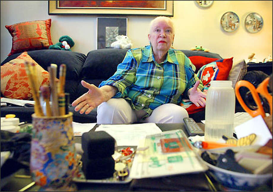 Bettina Brown's landlord is using an out-of-state company to calculate water bills in her apartment building. Her bill has nearly doubled in 15 months. Photo: Gilbert W. Arias/Seattle Post-Intelligencer
