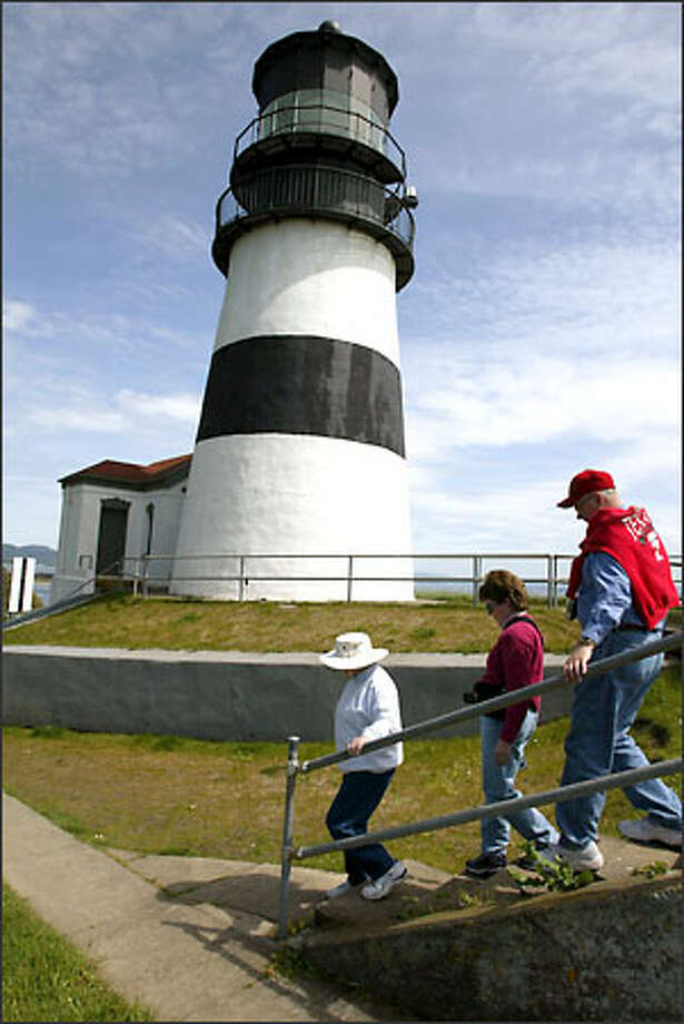 From left, Beverly Putnam of Salem, Ore., and Nadine and Dick Bartsch of Lubbock, Texas, visit the Cape Disappointment lighthouse. Photo: Meryl Schenker/Seattle P-I