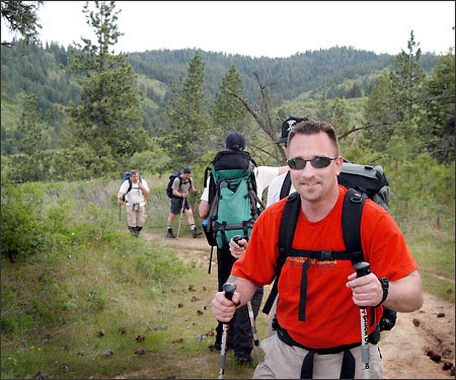 "Scott Galloway 35, of Puyallup trains with a backpack on Tower Mountain in Spokane last week. Galloway, now a member of the ""Mountain Goats,"" used to get high on cocaine and meth. Photo: / Associated Press"