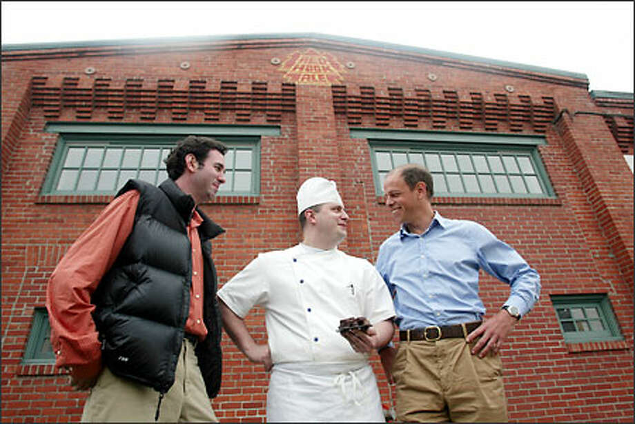 Chocolate maker Todd Kluger, left, chocolatier and pastry chef William Leaman and owner Jeff Fairhall of the Essential Baking Co. pause outside the old Redhook Brewery in Fremont. Photo: KAREN DUCEY/P-I PHOTO