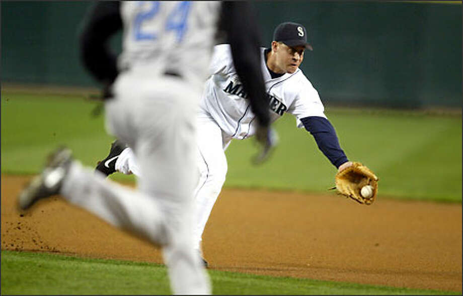 Second baseman Bret Boone, a big proponent of the Mariners' defensive abilities, scoops up a first-inning bunt attempt by Kansas City's Michael Tucker. Photo: Scott Eklund/Seattle Post-Intelligencer