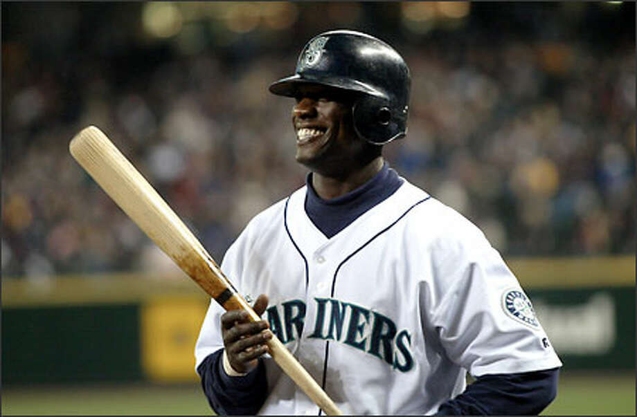 """Mariners center fielder Mike Cameron chuckles at an image of himself singing on the big screen in a version of """"American Idol."""" Cameron hit a run-scoring double in the eighth inning. Photo: Scott Eklund/Seattle Post-Intelligencer"""