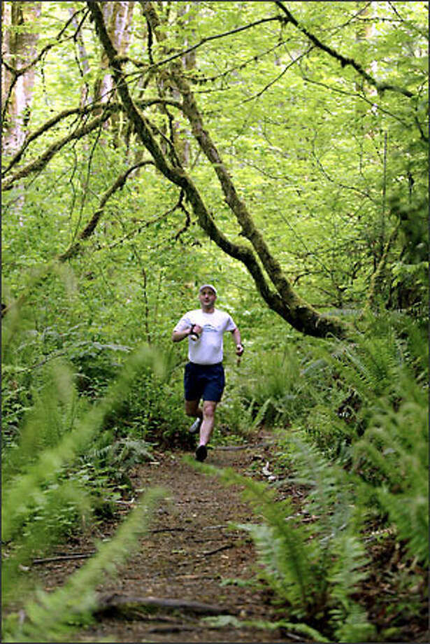 Noah Domont runs at Cougar Mountain Park, which will have its first trail running competition this summer Photo: Scott Eklund/Seattle Post-Intelligencer