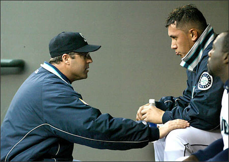 Mariners pitching coach Bryan Price consoles starting pitcher Freddy Garcia after he allowed four runs in the first inning against the Royals. Photo: Scott Eklund/Seattle Post-Intelligencer