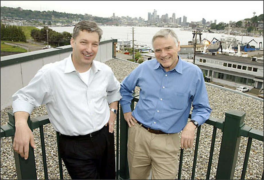 Carl Weissman, president and CEO of Accelerator, said the firm chose to set up a biotechnology incubator in Seattle because of Leroy Hood, right. Photo: Meryl Schenker/Seattle Post-Intelligencer