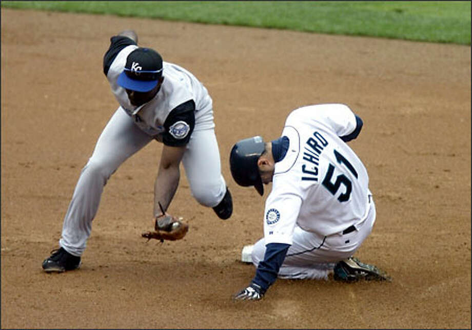 Ichiro Suzuki slides into second base ahead of the throw to Kansas City's Carlos Febles on a third-inning steal. Photo: Karen Ducey/Seattle Post-Intelligencer