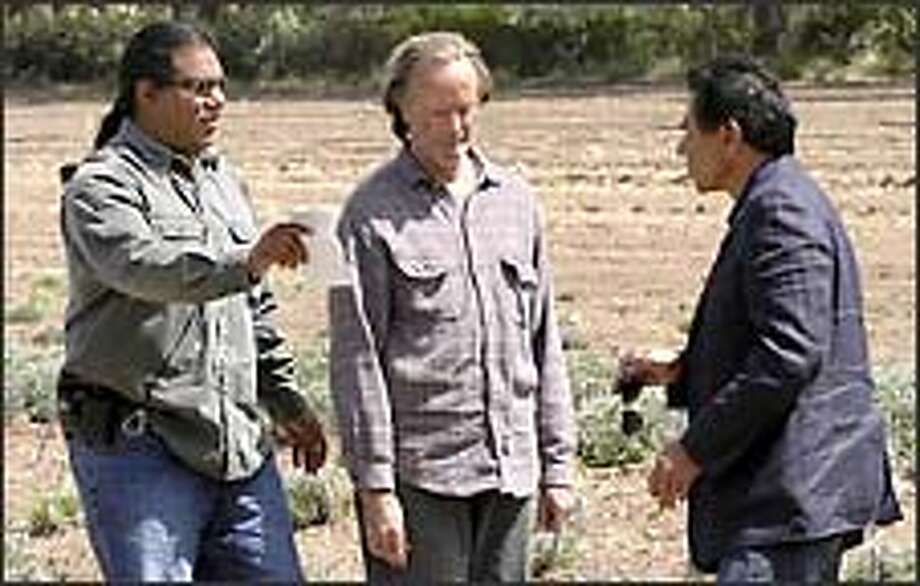 "Director Chris Eyre, left, explains a scene from ""A Thief of Time"" to Peter Fonda, center, who plays rancher and ex-legislator Harrison Houk, and Wes Studi, who plays Navajo tribal policeman Lt. Joe Leaphorn. Photo: Associated Press"