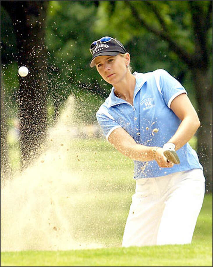 Golfer Annika Sorenstam hits from the sand on the first hole during the second round of the Colonial golf tournament at the Colonial Country Club in Fort Worth, Texas. Photo: / Associated Press
